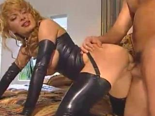sexy woman in latex sucks and fucks a cock