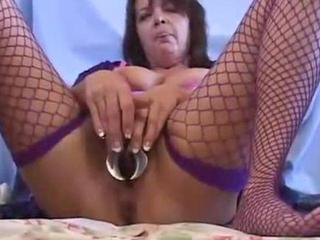 mature woman stuffing toys in her pussy