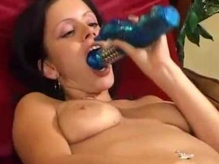 hot amateur girl sticks her dildo in her pussy